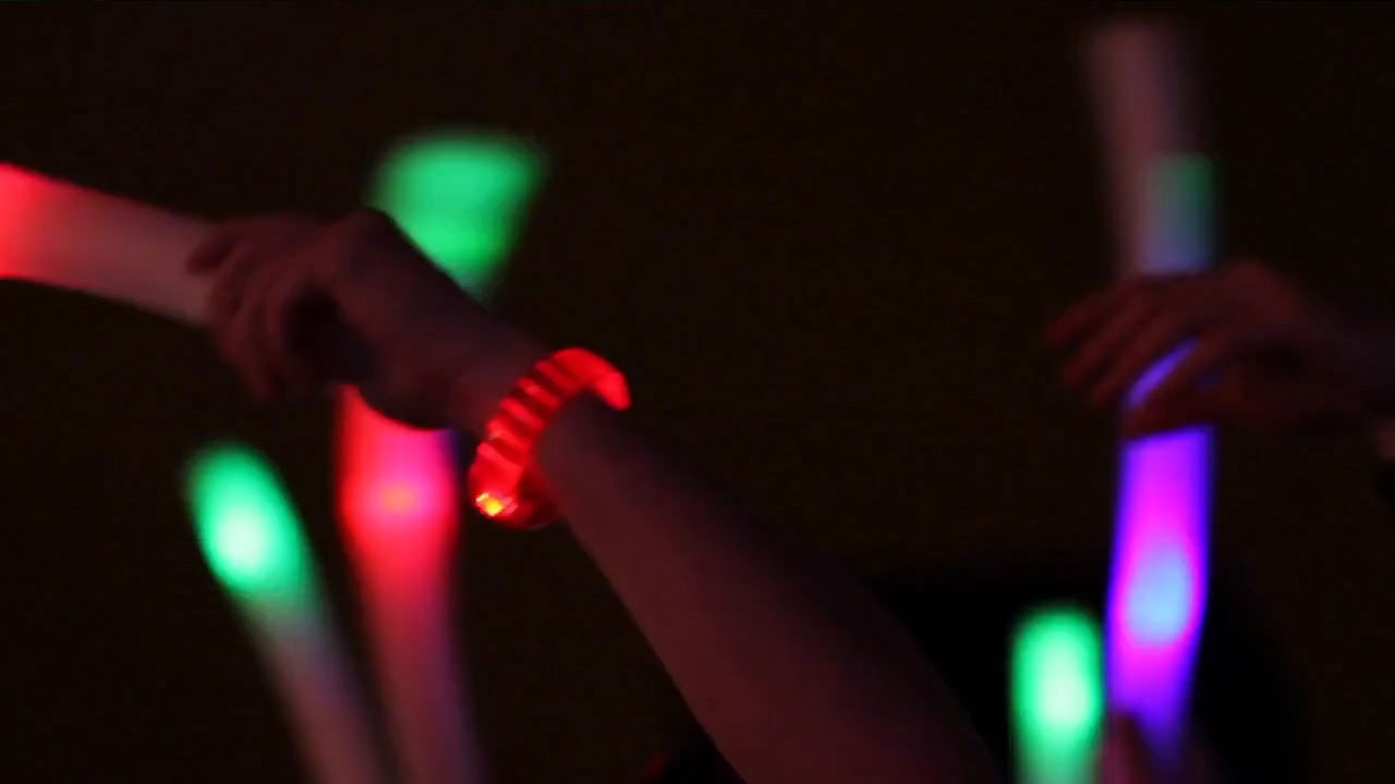 Hands in the air waving the light it up lightband