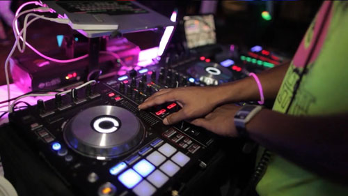 A DJ mixing on the latest DJ equipment technology