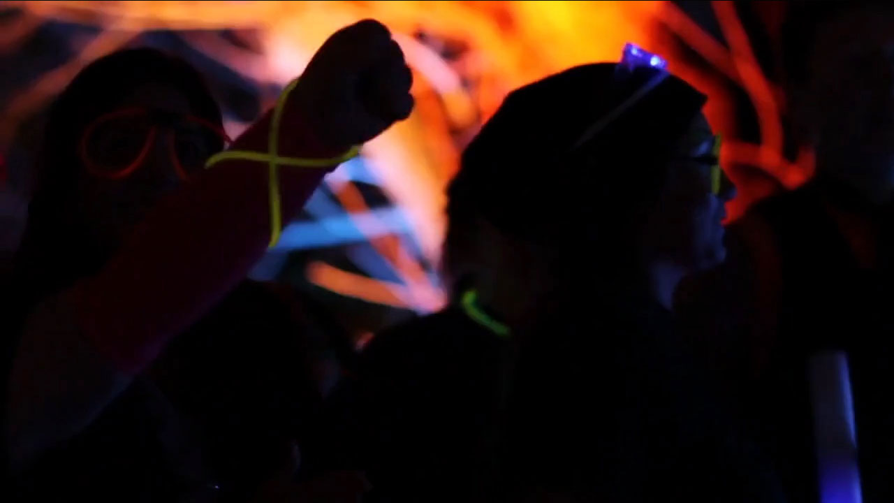 Glow in the dark raver at a light it up party