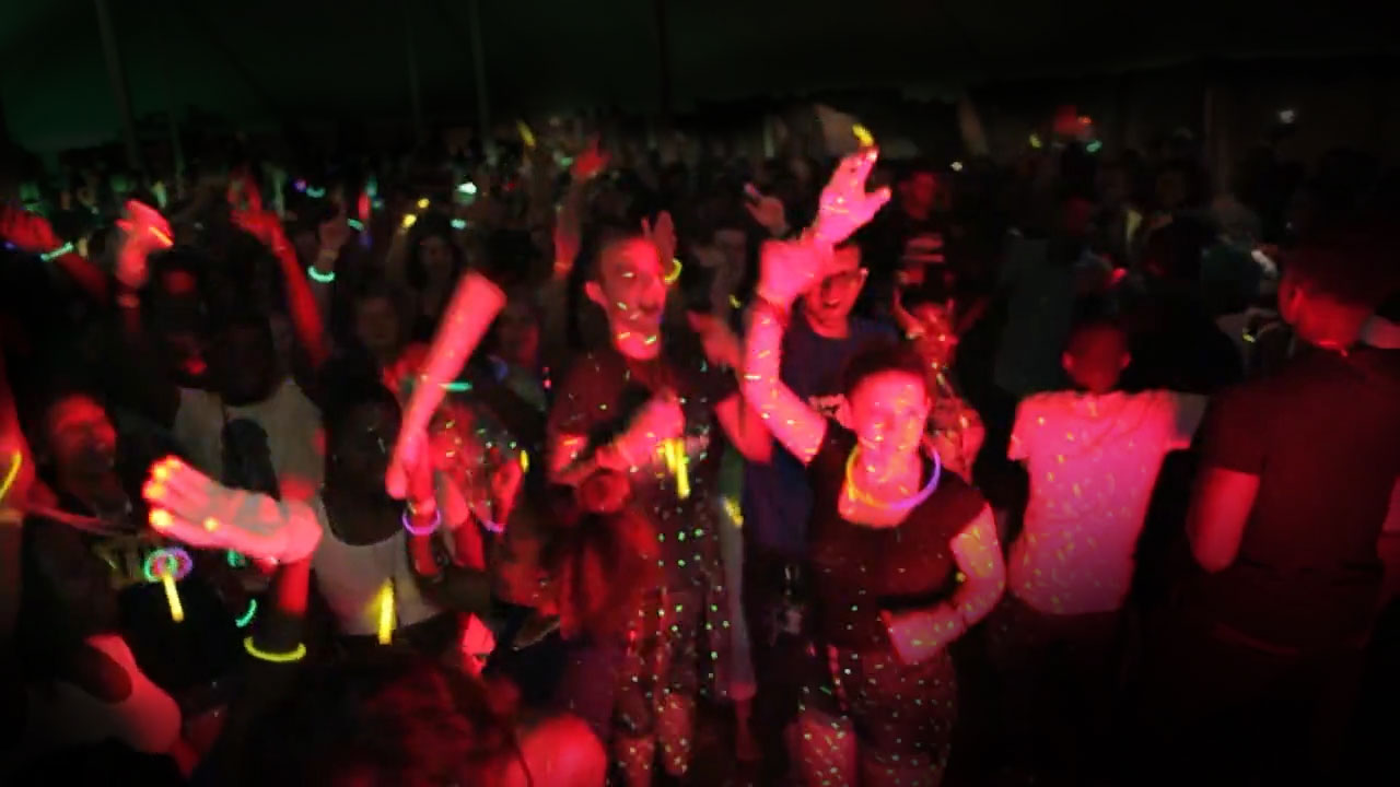 The crowd dancing at a Light it Up Party